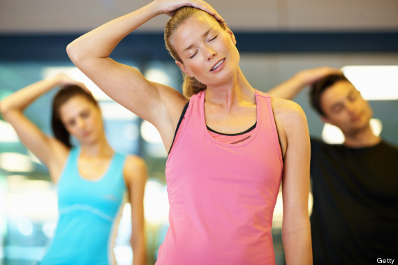 Woman stretching her neck at gym